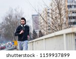 hipster sports man jogging in... | Shutterstock . vector #1159937899