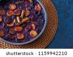 oven baked plums with cinnamon... | Shutterstock . vector #1159942210