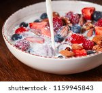 milk is pouring into homemade... | Shutterstock . vector #1159945843