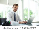 happy young businessman using... | Shutterstock . vector #1159948249