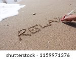 Relax Word Handwritten On Beach ...