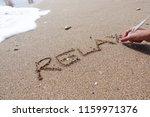 Relax Word Handwritten On Beac...