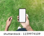 man holding phone showing blank ... | Shutterstock . vector #1159974109