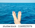 barefoot woman by the sea | Shutterstock . vector #1160025376