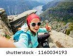 sportive smiling woman hiker in ... | Shutterstock . vector #1160034193
