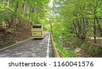 the going up bus to on the road ... | Shutterstock . vector #1160041576