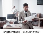 discussing a project. two black ...   Shutterstock . vector #1160045959