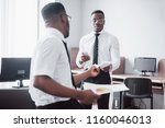 discussing a project. two black ...   Shutterstock . vector #1160046013