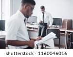 discussing a project. two black ...   Shutterstock . vector #1160046016