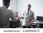 discussing a project. two black ...   Shutterstock . vector #1160046073