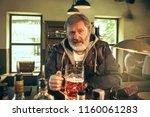 sad senior bearded man drinking ...   Shutterstock . vector #1160061283