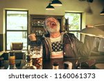 senior bearded man drinking...   Shutterstock . vector #1160061373