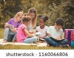 teaching in public park is fun... | Shutterstock . vector #1160066806