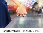 young couple in love holding... | Shutterstock . vector #1160072443