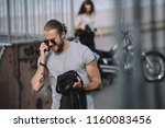 man talking on smartphone while ... | Shutterstock . vector #1160083456