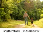 father and son of a cowboy | Shutterstock . vector #1160086849