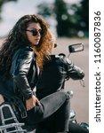 couple of bikers in black... | Shutterstock . vector #1160087836