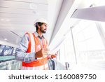 young indian engineer holding... | Shutterstock . vector #1160089750