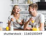 couple having breakfast and... | Shutterstock . vector #1160100349