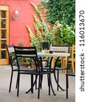 Table with chairs in a cafe terrace - stock photo