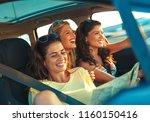 three female friends enjoying... | Shutterstock . vector #1160150416