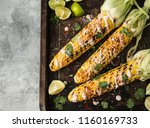 Grilled corn cobs with sauce ...