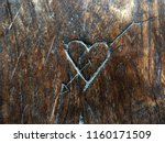 Hearts And Arrows Carved Onto...