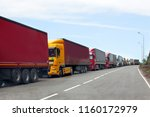 queue of trucks passing the... | Shutterstock . vector #1160172979
