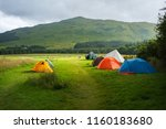 colorful tents on a meadow in...