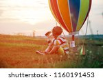 child playing in aviator with... | Shutterstock . vector #1160191453