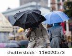 People Walking With Umbrellas...