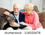 Senior Couple At Home With...