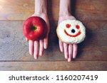 choosing between red apple and... | Shutterstock . vector #1160207419