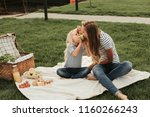 positive lady eating green... | Shutterstock . vector #1160266243