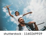 low angle portrait of laughing... | Shutterstock . vector #1160269939