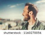 feeling happy. close up side... | Shutterstock . vector #1160270056