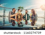 cheers. two young couples... | Shutterstock . vector #1160274739