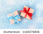 two gift boxes wrapped in kraft ... | Shutterstock . vector #1160276836