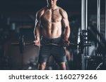 bodybuilder is straining all... | Shutterstock . vector #1160279266
