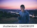 loneliness handsome man using... | Shutterstock . vector #1160280199