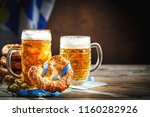 beer mugs and pretzels on a... | Shutterstock . vector #1160282926