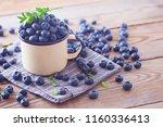lots of fresh blueberries  ... | Shutterstock . vector #1160336413