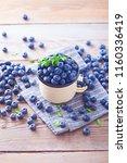 lots of fresh blueberries  ... | Shutterstock . vector #1160336419