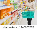 young asian woman with basket... | Shutterstock . vector #1160337076