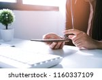 woman working by using a laptop ... | Shutterstock . vector #1160337109