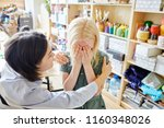young woman comforting crying... | Shutterstock . vector #1160348026