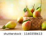 fresh ripe pears in basket on... | Shutterstock . vector #1160358613