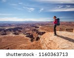 Hiker Rests In Canyonlands...