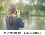 pretty cool young asian woman... | Shutterstock . vector #1160388889