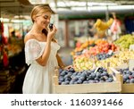 pretty young woman buying fresh ... | Shutterstock . vector #1160391466